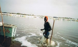 Brother digging up Salt from Lac Rose